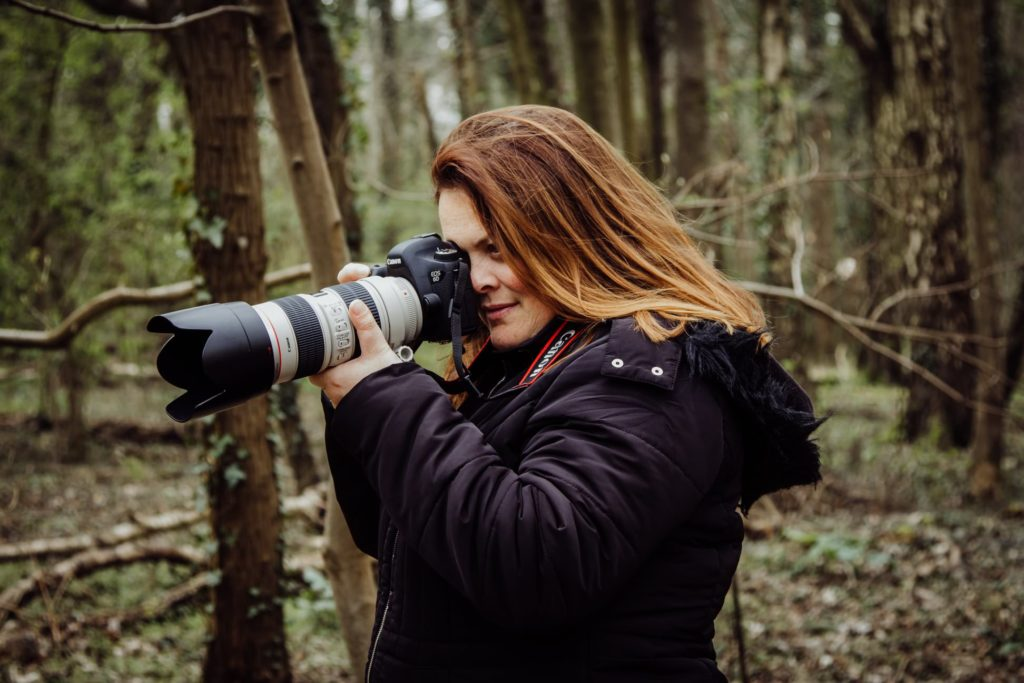 Wedding photographer - Cat Stephens in the forest with her camer a- Gay Wedding Blog