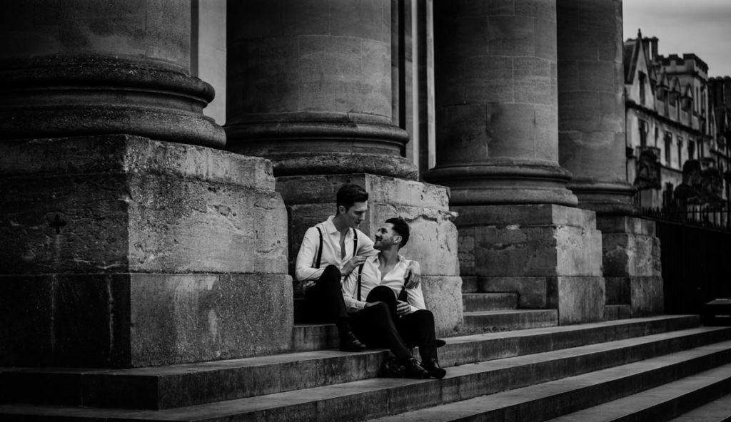 Black and white Picture of two grooms taken by a wedding photographer Cat Stephen