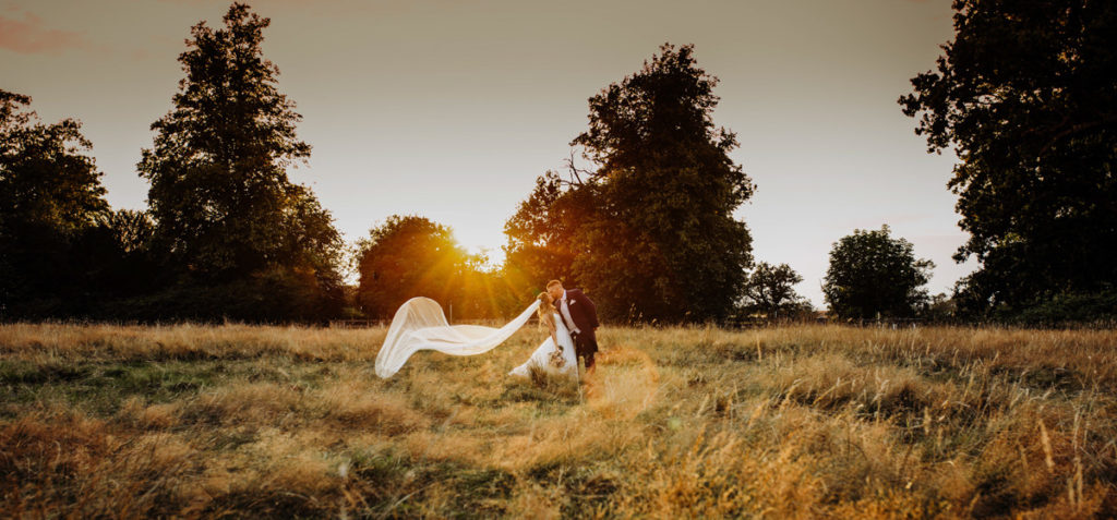 Picture of a wedding couple taken at sunset by a wedding photographer Cat Stephen
