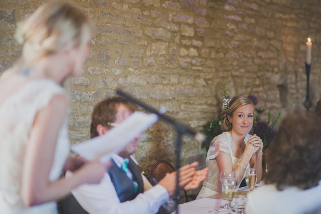Picture of a brides listening to a speech at a wedding - Gay Wedding Blog