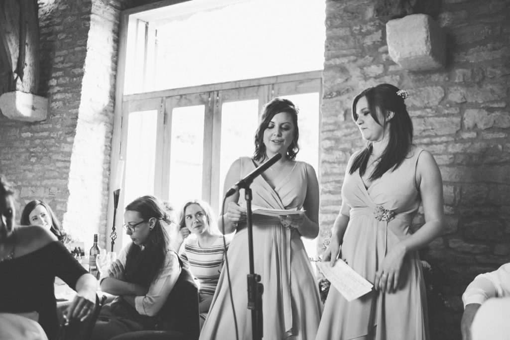 Picture of two bridesmaids giving a speech at a wedding - Gay Wedding Blog
