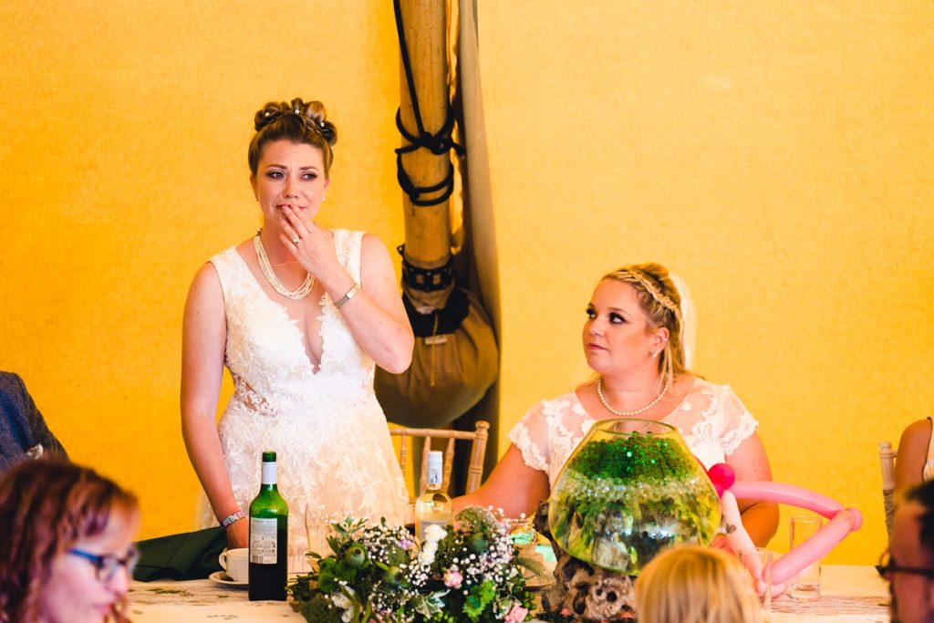 Picture of two brides giving a speech at a wedding - Gay Wedding Blog