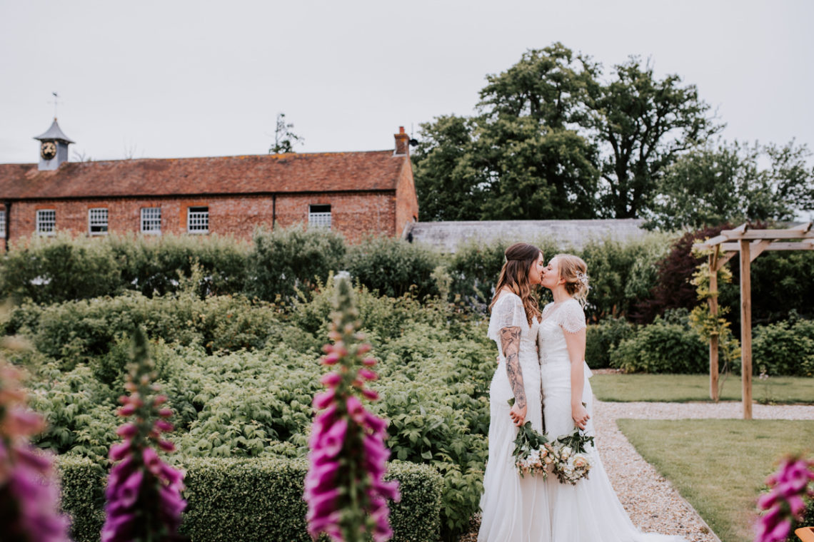 Two brides in the garden - same sex wedding at Gay Wedding Blog